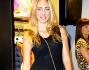 Cristel Carrisi in abito estivo nero che non lascia spazio fantasia alla lingerie blue