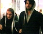 Paparazzati per il centro di Milano dopo aver fatto alcuni acquisti: Gianfranco Apicerni e Lucrezia Gizzi