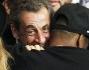 Jay-Z saluta calorosamente l'ex premier francese Nicolas Sarkozy