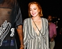 Lindsay Lohan tenendo per mano l'amico Vas J. Morgan