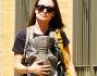 In formissima a spasso con Otis nel marsupio: Olivia Wilde non lascia intravedere il piccolo