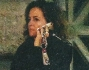 In quest'immagine pubblicata da Diva e Donna, Chiara Giordano, ancora moglie di Bova, al telefono mentre aspetta Raoul davanti al Cinema Adriano a Roma