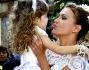 Eva Henger abbraccia la sua piccola Jennifer avuta da Massimiliano Caroletti