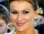 Eva Henger sorride emozionata ai fotografi il giorno del suo matrimonio celebratosi nella bellissima cornice romana di Caracalla