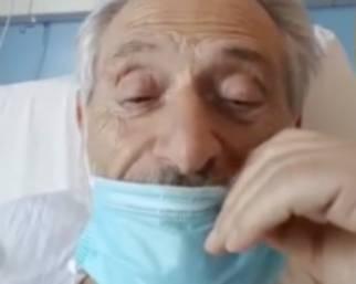 Amedeo Minghi in ospedale con la mascherina